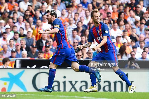 Lionel Messi of FC Barcelona celebrates with his team mate Ivan Rakitic after scoring his team's first goal during the La Liga match between Valencia...