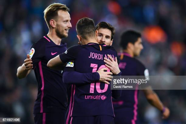 Lionel Messi of FC Barcelona celebrates with his team mate Jordi Alba after Ivan Rakitic of FC Barcelona scored his team's second goal during the La...