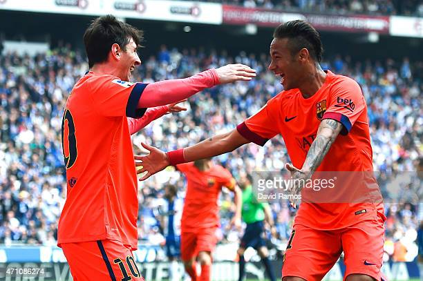 Lionel Messi of FC Barcelona celebrates with his team mate Neymar of FC Barcelona after scoring his team's second goal during the La Liga match...