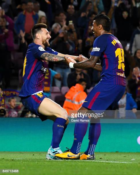 Lionel Messi of FC Barcelona celebrates with his team mate Paulinho after scoring his team's fifth goal during the La Liga match between Barcelona...