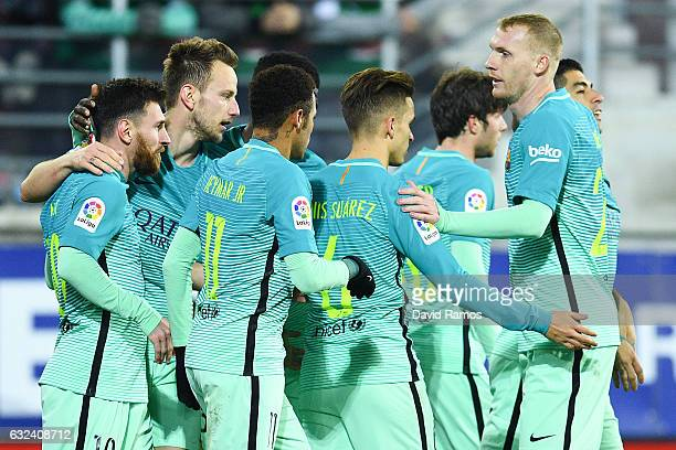 Lionel Messi of FC Barcelona celebrates with his team mates after scoring his team's second goal during the La Liga match between SD Eibar and FC...