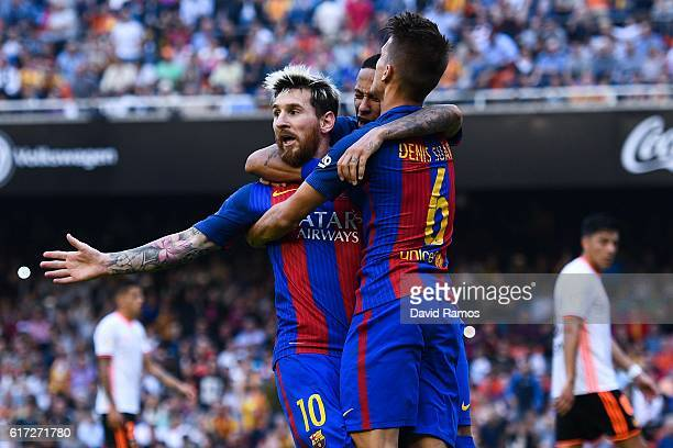 Lionel Messi of FC Barcelona celebrates with his team mates Neymar Jr and Denis Suarez after scoring his team's third from the penalty spot goal...