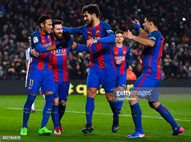 Lionel Messi of FC Barcelona celebrates with his team mates Neymar Jr Andre Gomes and Luis Suarez after scoring from the penalty spot his team's...