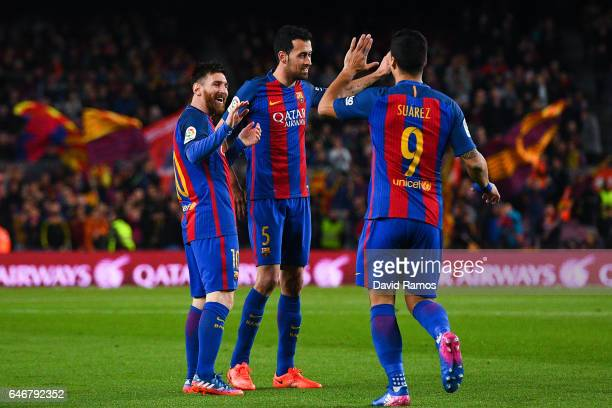 Lionel Messi of FC Barcelona celebrates with his team mates Sergio Busquets and Luis Suarez of FC Barcelona after scoring the opening goal during the...