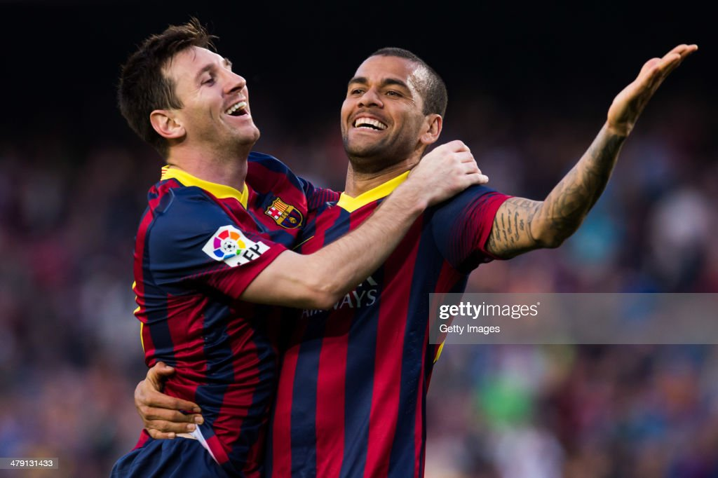 <a gi-track='captionPersonalityLinkClicked' href=/galleries/search?phrase=Lionel+Messi&family=editorial&specificpeople=453305 ng-click='$event.stopPropagation()'>Lionel Messi</a> of FC Barcelona celebrates with his teammate Daniel Alves after scoring his team's sixth goal during the La Liga match between FC Barcelona and CA Osasuna at Camp Nou on March 16, 2014 in Barcelona, Spain.