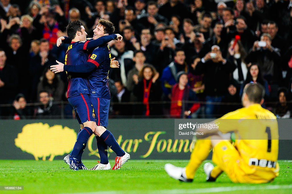 FC <a gi-track='captionPersonalityLinkClicked' href=/galleries/search?phrase=Lionel+Messi&family=editorial&specificpeople=453305 ng-click='$event.stopPropagation()'>Lionel Messi</a> of FC Barcelona celebrates with his team-mate <a gi-track='captionPersonalityLinkClicked' href=/galleries/search?phrase=David+Villa&family=editorial&specificpeople=467566 ng-click='$event.stopPropagation()'>David Villa</a> after scoring his team's second goal during the La Liga match between FC Barcelona and Rayo Vallecano at Camp Nou on March 17, 2013 in Barcelona, Spain.