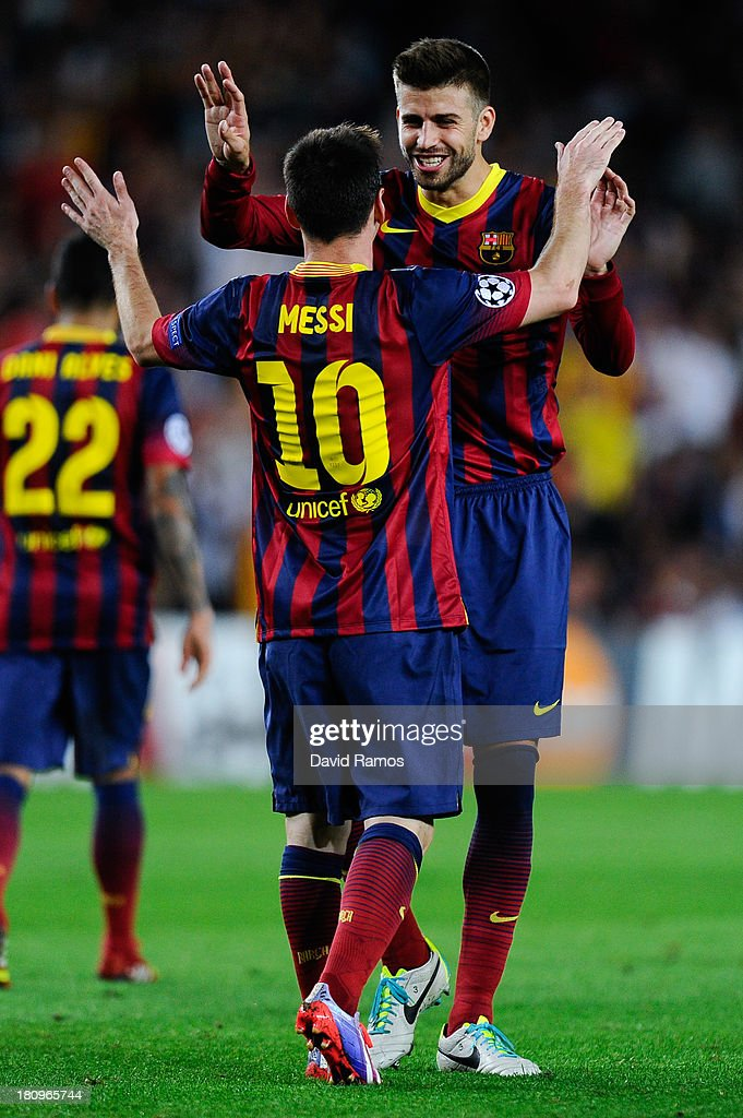 <a gi-track='captionPersonalityLinkClicked' href=/galleries/search?phrase=Lionel+Messi&family=editorial&specificpeople=453305 ng-click='$event.stopPropagation()'>Lionel Messi</a> of FC Barcelona celebrates with his team-mate <a gi-track='captionPersonalityLinkClicked' href=/galleries/search?phrase=Gerard+Pique&family=editorial&specificpeople=227191 ng-click='$event.stopPropagation()'>Gerard Pique</a> after scoring his team's fourth goal during the UEFA Champions League Group H match between FC Barcelona and Ajax Amsterdam ag the Camp Nou stadium on September 18, 2013 in Barcelona, Spain.