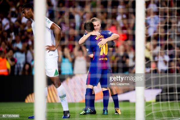 Lionel Messi of FC Barcelona celebrates with his teammate Gerard Deulofeu after scoring his team's third goal during the Joan Gamper Trophy match...