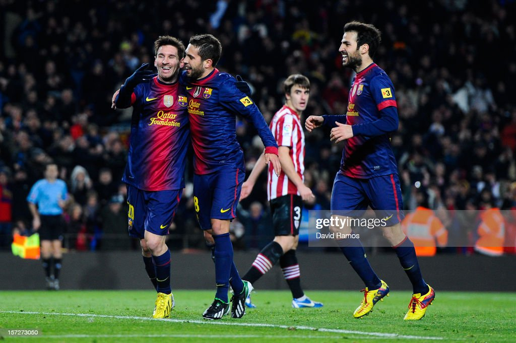 Lionel Messi of FC Barcelona celebrates with his teammate Jordi Alba (C) and Cesc Fabregas after scoring his team's fifth goal during the La Liga match between FC Barcelona and Athletic Club at Camp Nou on December 1, 2012 in Barcelona, Spain.