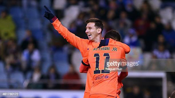 Lionel Messi of FC Barcelona celebrates with his teammate Neymar as he scored the first goal during the La Liga match between RC Deportivo and FC...