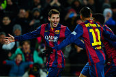 Lionel Messi of FC Barcelona celebrates with his teammate Neymar of FC Barcelona after scoring his team's third goal during the La Liga match between...