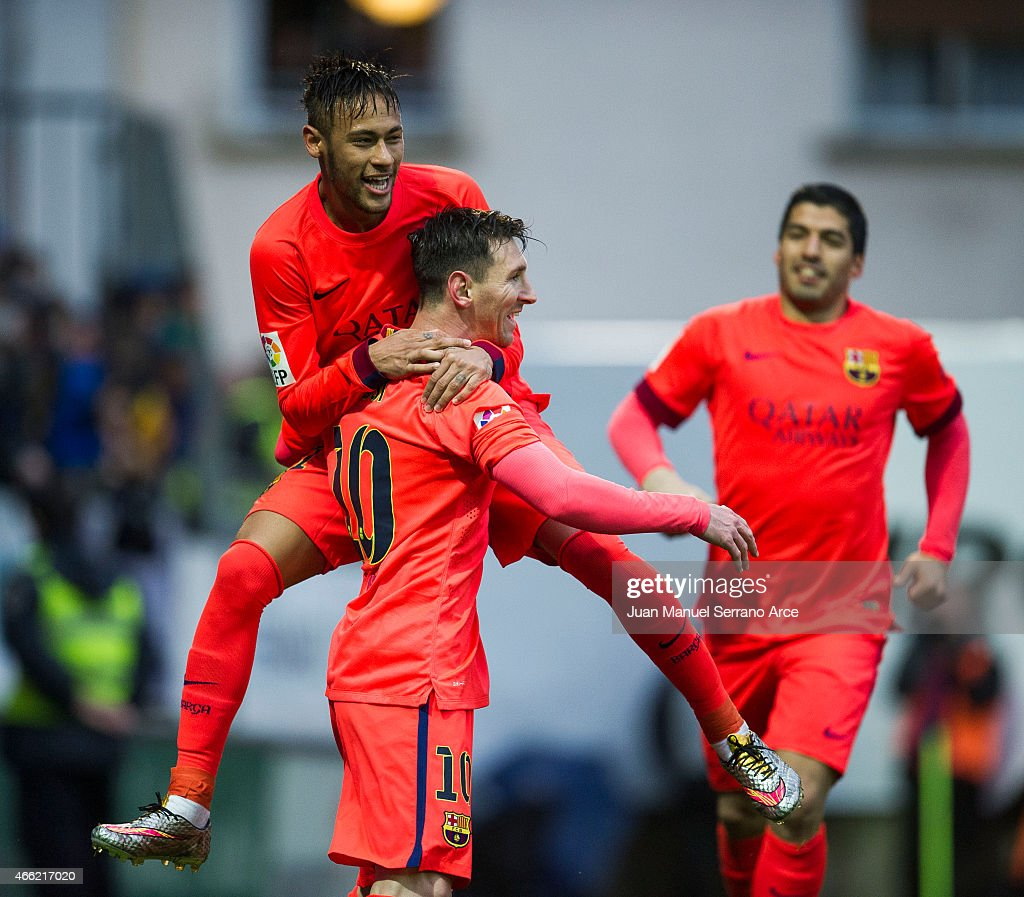 Lionel Messi of FC Barcelona celebrates with his teammate Neymar of FC Barcelona after scoring his goal during the La Liga match between SD Eibar and FC Barcelona at Ipurua Municipal Stadium on March 14, 2015 in Eibar, Spain.