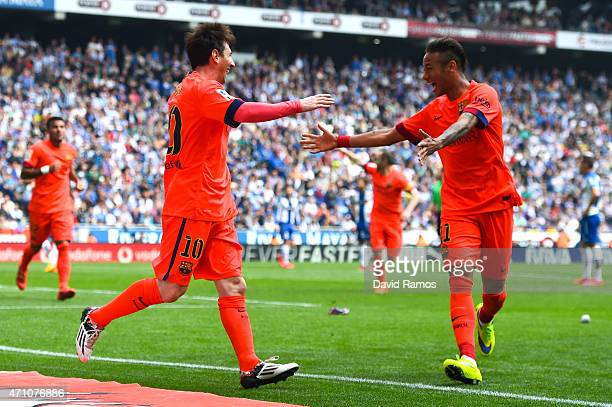Lionel Messi of FC Barcelona celebrates with his teammate Neymar of FC Barcelona after scoring his team's second goal during the La Liga match...