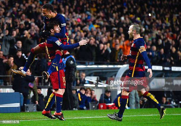 Lionel Messi of FC Barcelona celebrates with his teammate Neymar of FC Barcelona after scoring his team's second goal during the Copa del Rey Round...