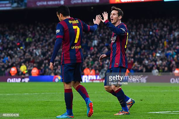 Lionel Messi of FC Barcelona celebrates with his teammate Pedro Rodriguez of FC Barcelona after scoring his team's third goal during the La Liga...