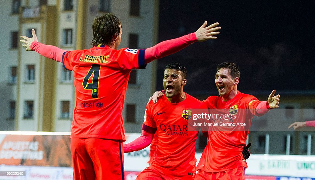 Lionel Messi of FC Barcelona celebrates with his teammate Rafinha and Ivan Rakitic of FC Barcelona after scoring his goal during the La Liga match between SD Eibar and FC Barcelona at Ipurua Municipal Stadium on March 14, 2015 in Eibar, Spain.