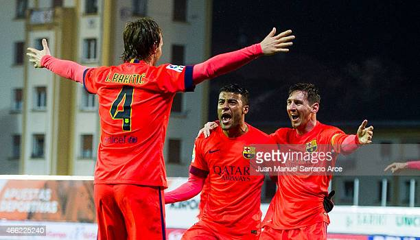 Lionel Messi of FC Barcelona celebrates with his teammate Rafinha and Ivan Rakitic of FC Barcelona after scoring his goal during the La Liga match...