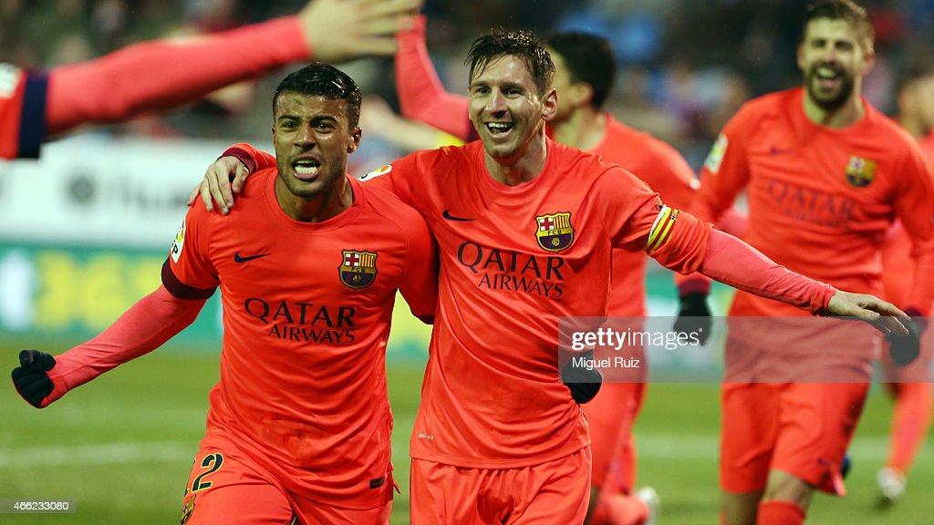 Lionel Messi of FC Barcelona celebrates with his team-mate Rafinha as he scored the second goal during the La Liga match between SD Eibar and FC Barcelona at Ipurua Municipal Stadium on March 14, 2015 in Eibar, Spain.