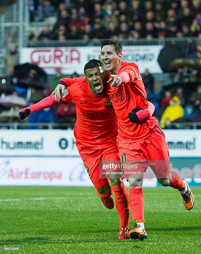 Lionel Messi of FC Barcelona celebrates with his teammate Rafinha of FC Barcelona after scoring his goal during the La Liga match between SD Eibar and FC Barcelona at Ipurua Municipal Stadium on March 14, 2015 in Eibar, Spain.