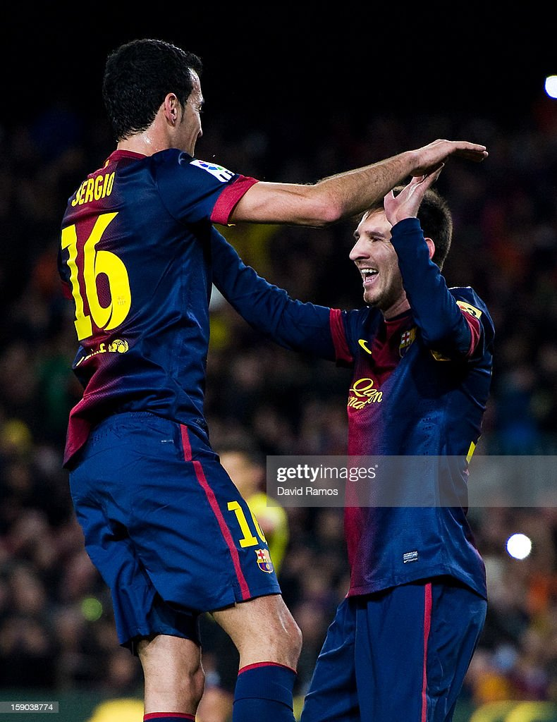 Lionel Messi of FC Barcelona celebrates with his teammate Sergio Busquets of FC Barcelona after scoring his team's fourth goal during the La Liga match between FC Barcelona and RCD Espanyol at Camp Nou on January 6, 2013 in Barcelona, Spain.