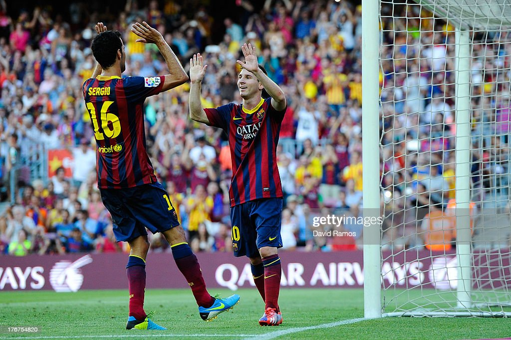 <a gi-track='captionPersonalityLinkClicked' href=/galleries/search?phrase=Lionel+Messi&family=editorial&specificpeople=453305 ng-click='$event.stopPropagation()'>Lionel Messi</a> of FC Barcelona celebrates with his team-mate <a gi-track='captionPersonalityLinkClicked' href=/galleries/search?phrase=Sergio+Busquets&family=editorial&specificpeople=5477015 ng-click='$event.stopPropagation()'>Sergio Busquets</a> after scoring his team's fifth goal during the La Liga match between FC Barcelona and Levante UD at Camp Nou on August 18, 2013 in Barcelona, Spain.