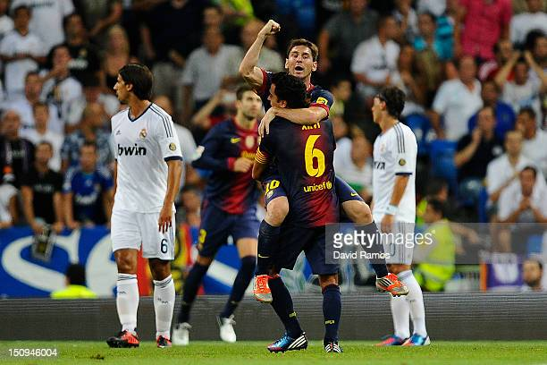 Lionel Messi of FC Barcelona celebrates with his teammate Xavi Hernandez after scoring his team's first goal during the Super Cup second leg match...
