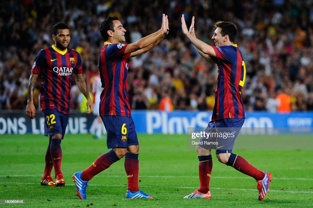 <a gi-track='captionPersonalityLinkClicked' href=/galleries/search?phrase=Lionel+Messi&family=editorial&specificpeople=453305 ng-click='$event.stopPropagation()'>Lionel Messi</a> (R) of FC Barcelona celebrates with his team-mate <a gi-track='captionPersonalityLinkClicked' href=/galleries/search?phrase=Xavi+Hernandez+-+Soccer+Player&family=editorial&specificpeople=2834438 ng-click='$event.stopPropagation()'>Xavi Hernandez</a> after scoring his team's fourth goal during the UEFA Champions League Group H match between FC Barcelona and Ajax Amsterdam ag the Camp Nou stadium on September 18, 2013 in Barcelona, Spain.