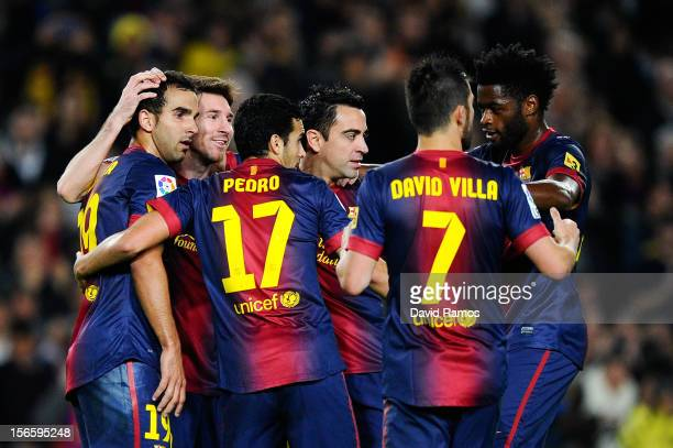 Lionel Messi of FC Barcelona celebrates with his teammates after scoring his team's third goal during the La Liga match between FC Barcelona and Real...