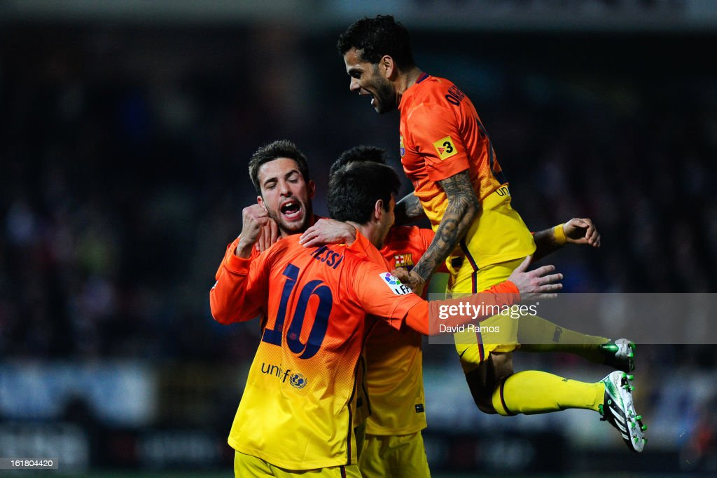 <a gi-track='captionPersonalityLinkClicked' href=/galleries/search?phrase=Lionel+Messi&family=editorial&specificpeople=453305 ng-click='$event.stopPropagation()'>Lionel Messi</a> of FC Barcelona celebrates with his team-mates after scoring his team's second goal during the La Liga match between Granada CF and FC Barcelona at Estadio Nuevo Los Carmenes on February 16, 2013 in Granada, Spain.