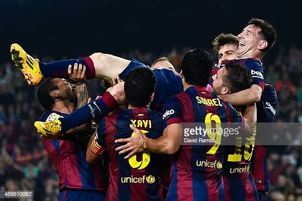 Lionel Messi of FC Barcelona celebrates with his teammates after scoring his team's fourth goal during the La Liga match between FC Barcelona and...