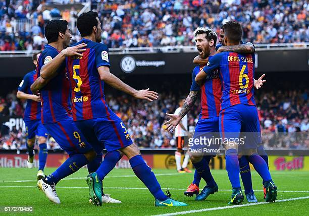 Lionel Messi of FC Barcelona celebrates with his teammates after scoring his team's third goal from the penalty spot during the La Liga match between...