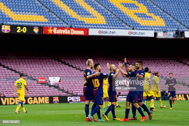 Lionel Messi of FC Barcelona celebrates with his teammates after scoring his team's third goal during the La Liga match between Barcelona and Las...