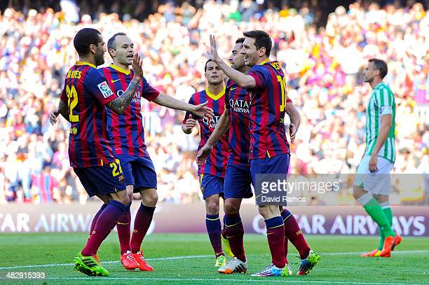 Lionel Messi of FC Barcelona celebrates with his teammates after scoring the opening goal during the La Liga match between FC Barcelona and Real...