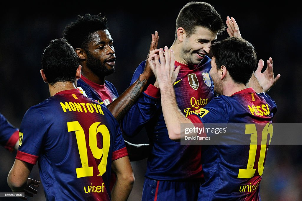 <a gi-track='captionPersonalityLinkClicked' href=/galleries/search?phrase=Lionel+Messi&family=editorial&specificpeople=453305 ng-click='$event.stopPropagation()'>Lionel Messi</a> of FC Barcelona (R) celebrates with his teammates <a gi-track='captionPersonalityLinkClicked' href=/galleries/search?phrase=Gerard+Pique&family=editorial&specificpeople=227191 ng-click='$event.stopPropagation()'>Gerard Pique</a> (C) and <a gi-track='captionPersonalityLinkClicked' href=/galleries/search?phrase=Alex+Song&family=editorial&specificpeople=652067 ng-click='$event.stopPropagation()'>Alex Song</a> after scoring the opening goal during the La Liga match between FC Barcelona and Real Zaragoza at Camp Nou on November 17, 2012 in Barcelona, Spain.
