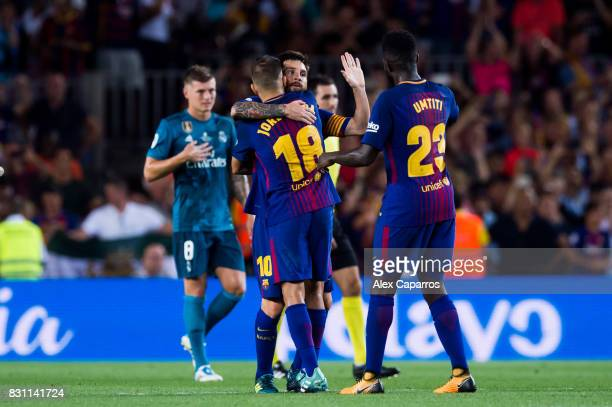 Lionel Messi of FC Barcelona celebrates with his teammates Jordi Alba and Samuel Umtiti after scoring his team's first goal during the Supercopa de...