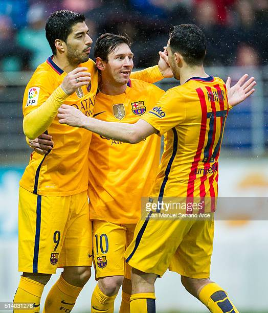 Lionel Messi of FC Barcelona celebrates with his teammates Luis Suarez and Munir El Haddadi of FC Barcelona after scoring his team's third goal...