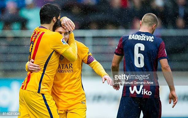 Lionel Messi of FC Barcelona celebrates with his teammates Luis Suarez of FC Barcelona after scoring his team's third goal during the La Liga match...