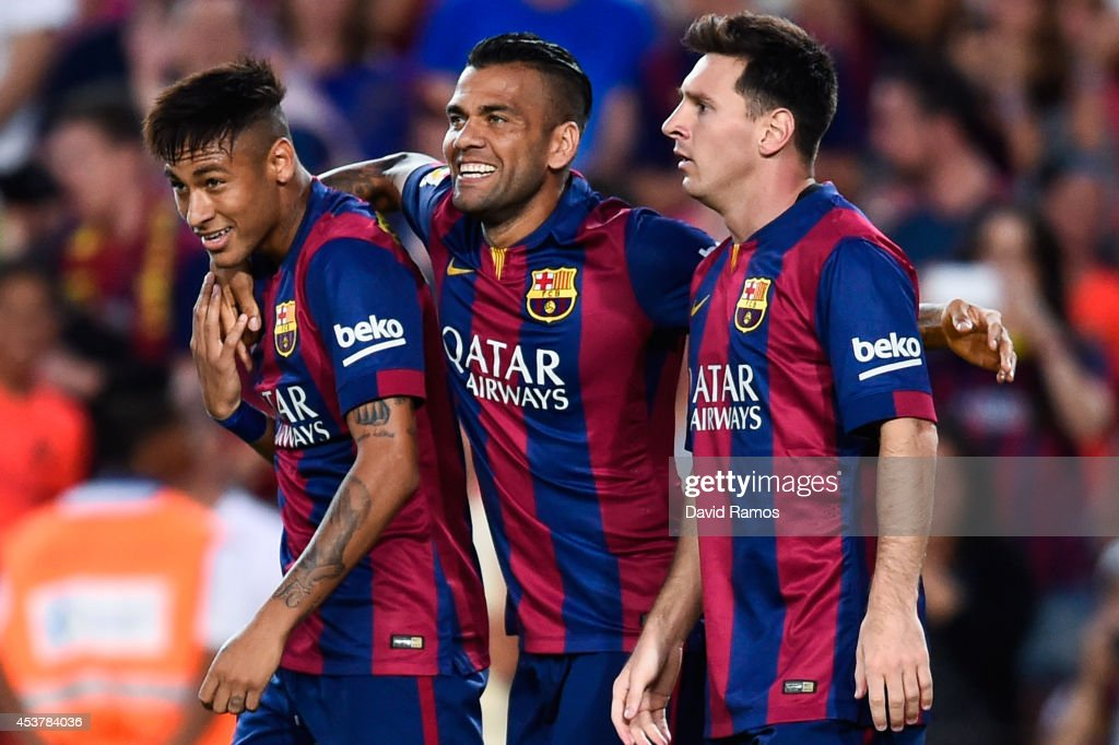 <a gi-track='captionPersonalityLinkClicked' href=/galleries/search?phrase=Lionel+Messi&family=editorial&specificpeople=453305 ng-click='$event.stopPropagation()'>Lionel Messi</a> of FC Barcelona celebrates with his teammates Neymar (L) and <a gi-track='captionPersonalityLinkClicked' href=/galleries/search?phrase=Dani+Alves&family=editorial&specificpeople=2191863 ng-click='$event.stopPropagation()'>Dani Alves</a> after scoring the opening goalduring the Joan Gamper Trophy match between FC Barcelona and Club Leon at Camp Nou on August 18, 2014 in Barcelona, Spain.