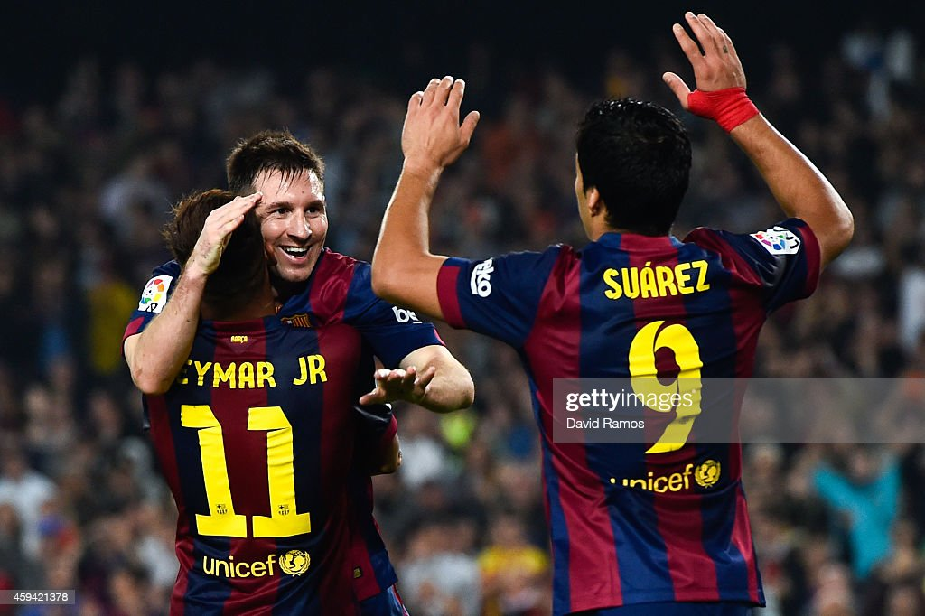 Lionel Messi of FC Barcelona celebrates with his teammates Neymar and Luis Suarez of FC Barcelona after scoring his team's fourth goal during the La...