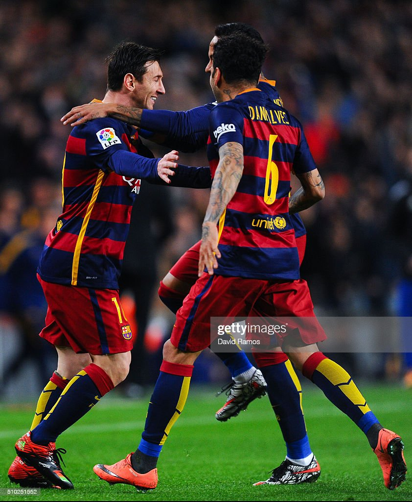<a gi-track='captionPersonalityLinkClicked' href=/galleries/search?phrase=Lionel+Messi&family=editorial&specificpeople=453305 ng-click='$event.stopPropagation()'>Lionel Messi</a> of FC Barcelona celebrates with his teammates Neymar and <a gi-track='captionPersonalityLinkClicked' href=/galleries/search?phrase=Dani+Alves&family=editorial&specificpeople=2191863 ng-click='$event.stopPropagation()'>Dani Alves</a> of FC Barcelona after scoring the opening goal during the La Liga match between FC Barcelona and Celta Vigo at Camp Nou on February 14, 2016 in Barcelona, Spain.