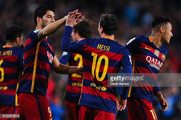 Lionel Messi of FC Barcelona celebrates with his teammates Neymar and Luis Suarez of FC Barcelona after scoring the opening goal during the La Liga...