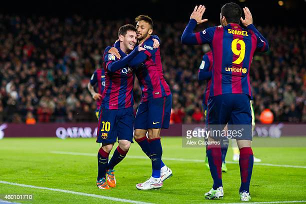 Lionel Messi of FC Barcelona celebrates with his teammates Neymar Santos Jr and Luis Suarez after scoring his second team's goal during the La Liga...
