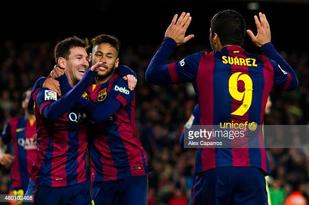 Lionel Messi of FC Barcelona celebrates with his teammates Neymar Santos Jr and Luis Suarez after scoring his team's second goal during the La Liga...