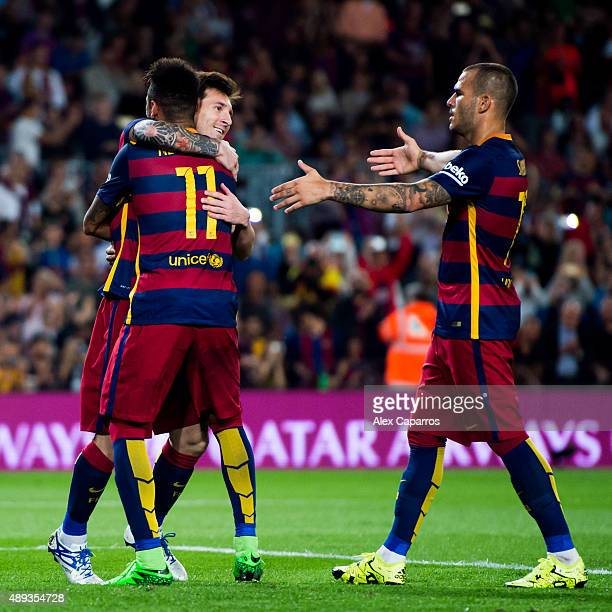 Lionel Messi of FC Barcelona celebrates with his teammates Neymar Santos Jr and Sandro Ramirez after scoring his team's third goal during the La Liga...