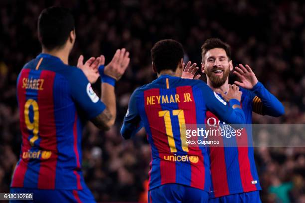 Lionel Messi of FC Barcelona celebrates with his teammates Neymar Santos Jr and Luis Suarez after scoring his team's fifth goal during the La Liga...