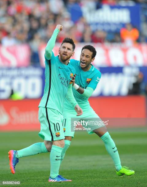 Lionel Messi of FC Barcelona celebrates with Neymar after scoring his 2nd goal during the La Liga match between Club Atletico de Madrid and FC...