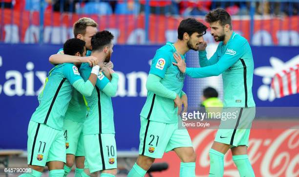 Lionel Messi of FC Barcelona celebrates with teammate Gerard Pique has a word with Andre Gomes after Messi scored Barcelona's 2nd goal during the La...
