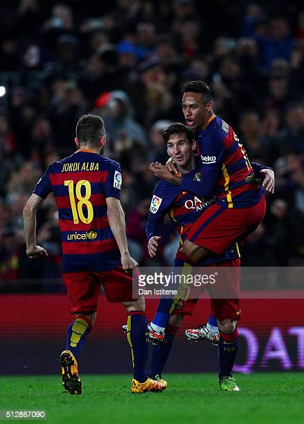Lionel Messi of FC Barcelona celebrates with teammates Neymar and Jordi Alba after scoring his team's first goal during the La Liga match between FC...