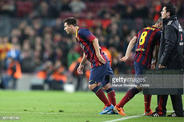 Lionel Messi of FC Barcelona comes on as a substitute for Andres Iniesta during the Copa del Rey round of 16 first leg football match between FC...