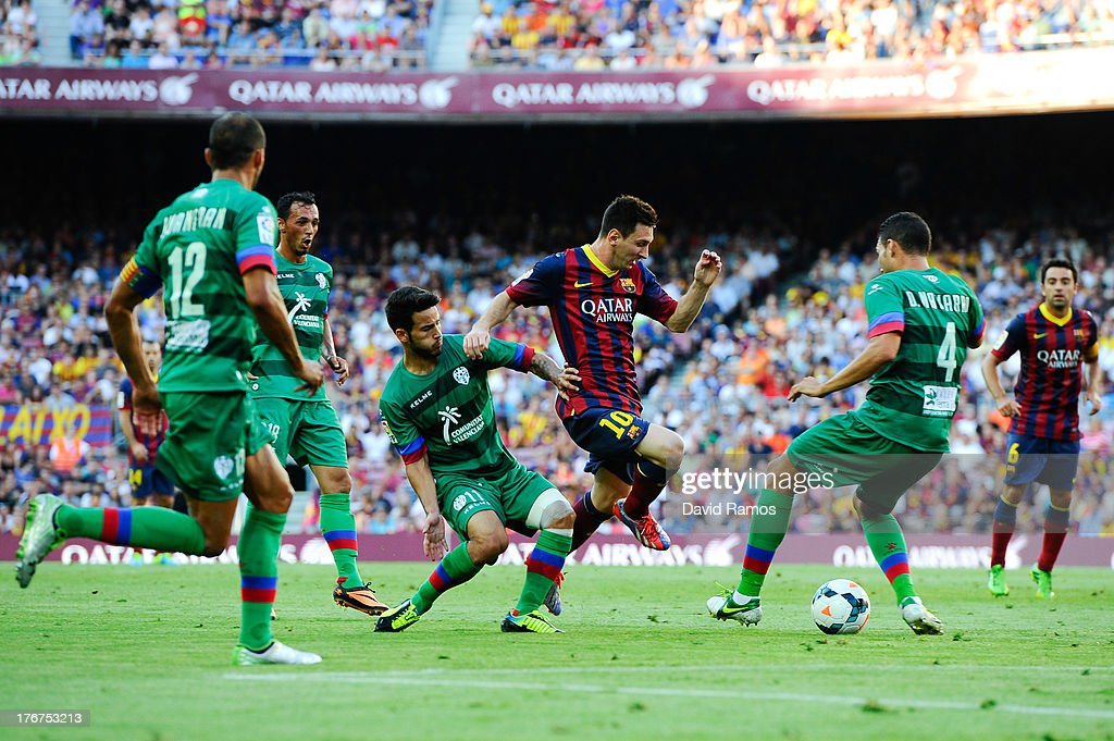 <a gi-track='captionPersonalityLinkClicked' href=/galleries/search?phrase=Lionel+Messi&family=editorial&specificpeople=453305 ng-click='$event.stopPropagation()'>Lionel Messi</a> of FC Barcelona competes for the ball among Levante UD players during the La Liga match between FC Barcelona and Levante UD at Camp Nou on August 18, 2013 in Barcelona, Spain.